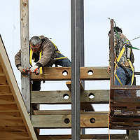 Adam Robison | BUY AT PHOTOS.DJOURNAL.COM<br /> Tim Denton, a employee for Lynn Bryan Construction, takes down a support beam on the cribbage on the veranda at the Spain House Wednesday afternoon in Tupelo.