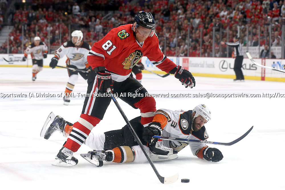 23 May 2015:  Chicago Blackhawks Right Wing Marian Hossa (81) [1098] battles Anaheim Ducks Defenceman Clayton Stoner (3) [3541] for a loose puck  during the first period of action during Game 4 of the Western Conference Finals between the Chicago Blackhawks and the Anaheim Ducks at the United Center in Chicago, IL.