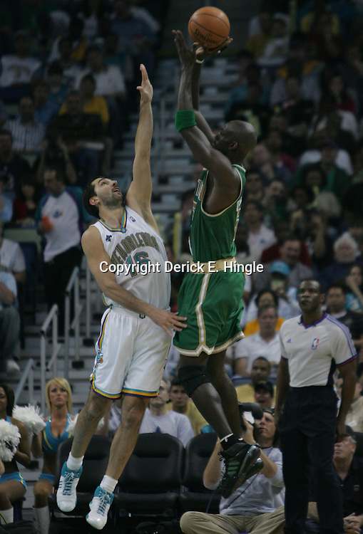 Kevin Garnett #5 of the Boston Celtics shoots over New Orleans Hornets forward Peja Stojakovic #16  in the second quarter of their NBA game on March 22, 2008 at the New Orleans Arena in New Orleans, Louisiana. The New Orleans Hornets defeated the Boston Celtics 113-106.