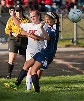 Belmont's Makayla Donovan and Bow's Christa Alfano battle for the ball during NHIAA DIvision III Soccer with Bow Tuesday afternoon.  (Karen Bobotas/for the Laconia Daily Sun)