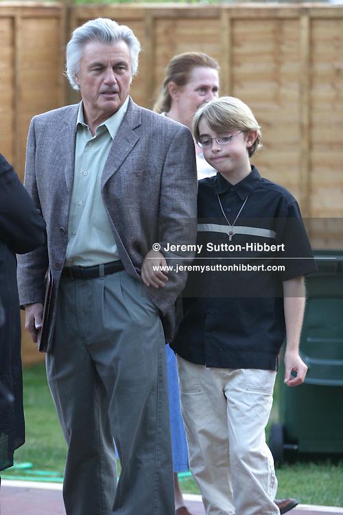 John Irving, American novelist, with son (?)...Edinburgh International Book Festival 2003, Edinburgh, Scotland.