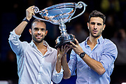 Juan Sebastian Cabal of Columbia (left) and Robert Farah  of Columbia celebrate with their trophy becoming ATP Doubles No 1during the Nitto ATP Finals at the O2 Arena, London, United Kingdom on 14 November 2019.