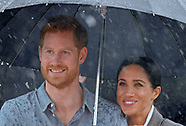 Meghan Markle & Prince Harry Get Close In Rain