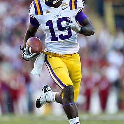 November 6, 2010; Baton Rouge, LA, USA;  LSU Tigers tight end Deangelo Peterson (19) runs with the ball on a reverse during the second half against the Alabama Crimson Tide at Tiger Stadium. LSU defeated Alabama 24-21.  Mandatory Credit: Derick E. Hingle
