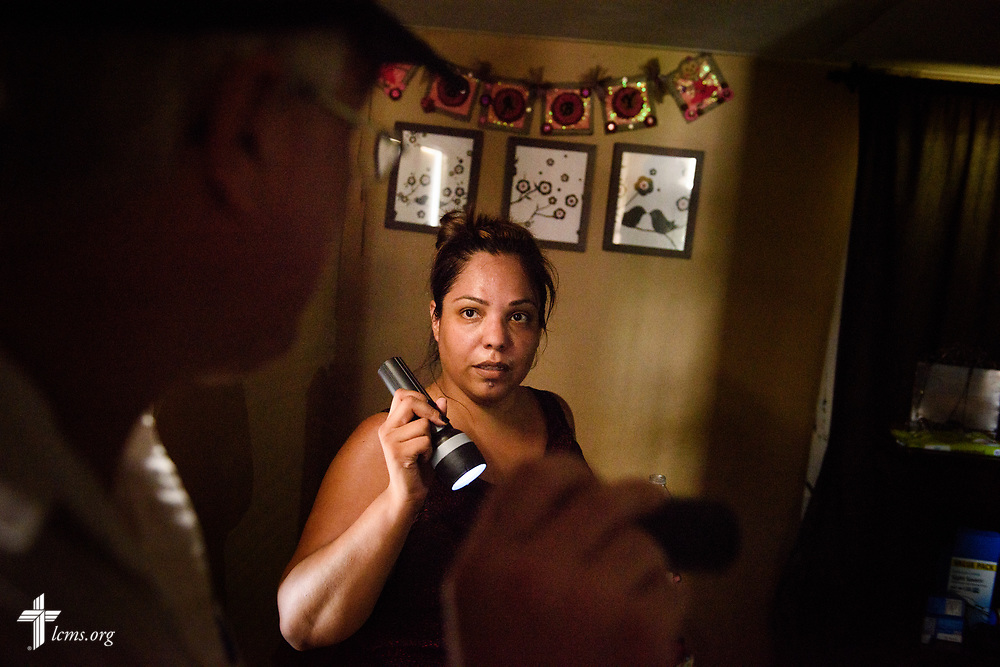 Evelyn Cardenas, a staff member at Amigos en Cristo Lutheran Mission in Bonita Springs, Fla., talks with the Rev. Bob Selle of the mission at her home on Wednesday, Sept. 13, 2017, in Bonita Springs. Cardenas' home was heavily damaged by Hurricane Irma. LCMS Communications/Erik M. Lunsford