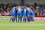AFC Wimbledon Team huddle prior the Sky Bet League 2 match between AFC Wimbledon and Exeter City at the Cherry Red Records Stadium, Kingston, England on 29 August 2015. Photo by Stuart Butcher.