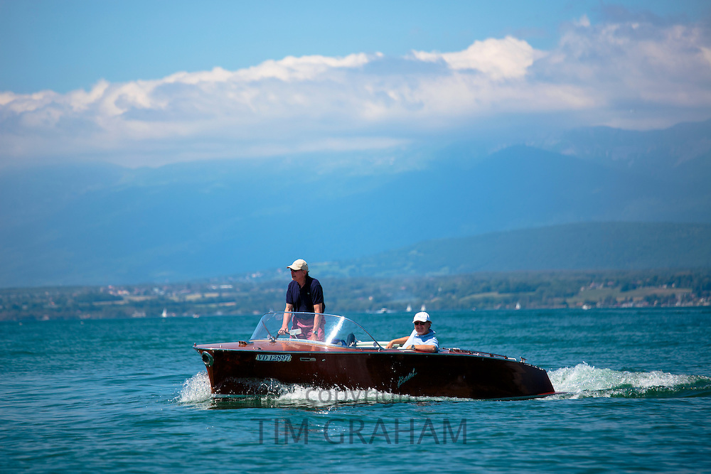 Powerboat Boesch Deluxe 5.6 luxury speedboat crosses Lac Leman, Lake Geneva, near Evian-les-Bains, France