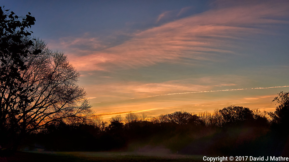 Clouds at dawn. Image taken with a Leica T camera and 18-56 mm zoom lens (ISO 100, 22 mm, f/4.5, 1/160 sec).
