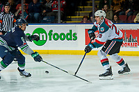 KELOWNA, CANADA - JANUARY 5: Nolan Foote #29 of the Kelowna Rockets passes the puck away from Jarret Tyszka #5 of the Seattle Thunderbirds on January 5, 2017 at Prospera Place in Kelowna, British Columbia, Canada.  (Photo by Marissa Baecker/Shoot the Breeze)  *** Local Caption ***