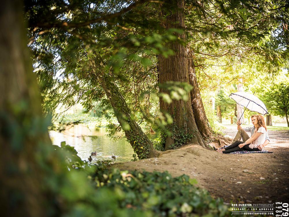 Couple beside lake in Phoenix Park, Dublin