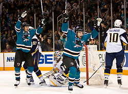 January 23, 2010; San Jose, CA, USA; San Jose Sharks left wing Dany Heatley (15) and defenseman Rob Blake (4) react after scoring past Buffalo Sabres goalie Ryan Miller (30) during the second period at HP Pavilion. San Jose defeated Buffalo 5-2. Mandatory Credit: Jason O. Watson / US PRESSWIRE