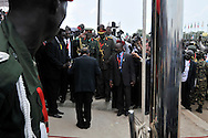 President Omar al-Bashir of Sudan, accused of genocide, crimes against humanity and war crimes, receiving and kissing the country's flag after it was lowered before the raising of the new flag of the Republic of South Sudan at the official independence day ceremony. After decades of conflict, Southern Sudan declared independence from the North on July 9th, 2011. Government officials, foreign dignitaries and ordinary people came to the John Garang Memorial in the capital from all over the country and the world to celebrate the historic occation..Juba, South Sudan. 09/07/2011..Photo © J.B. Russell