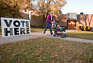 Vickie Quinones, of Des Moines, leaves a voting location with her son Benjamin, 19 months, in Des Moines, Iowa on Tuesday November 2, 2010. (Stephen Mally for The New York Times)