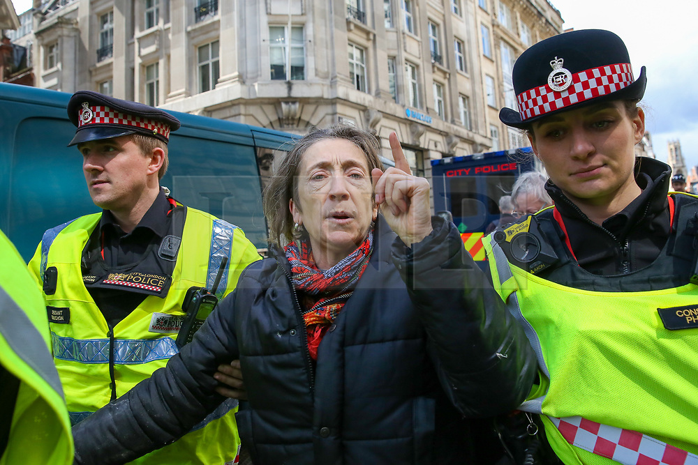 © Licensed to London News Pictures. 25/04/2019. London, UK. City of London Police detains an environmental activists from Extinction Rebellion Movement Group on Fleet Street in City of London following their ongoing action demanding decisive action from the UK Government on the environmental crisis. Photo credit: Dinendra Haria/LNP