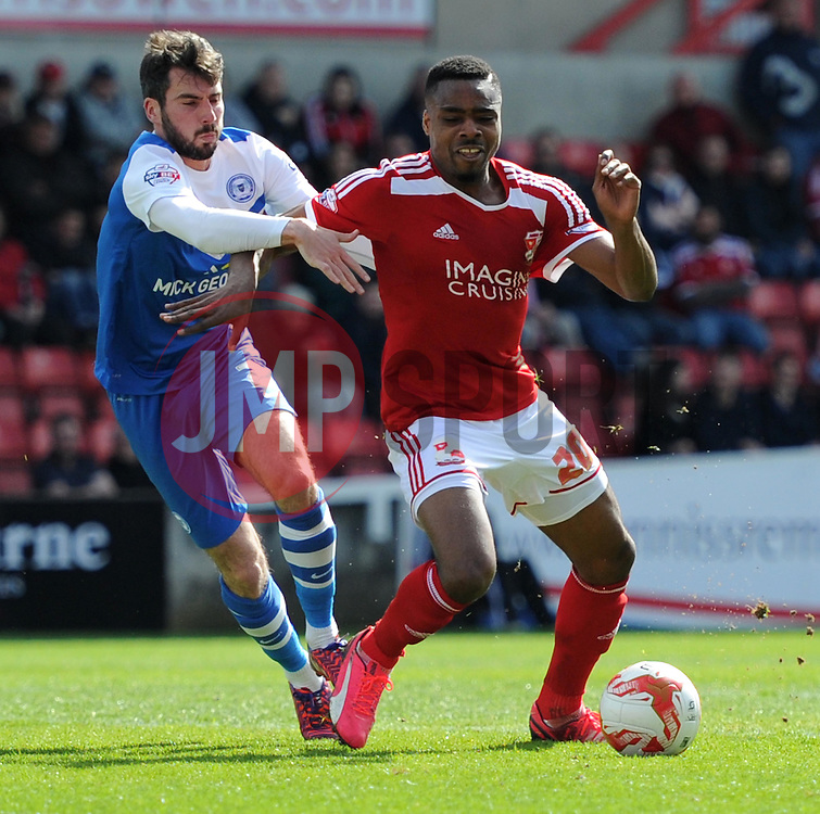 Peterborough United's Michael Smith battles with Swindon Town's Jon Obika - Photo mandatory by-line: Paul Knight/JMP - Mobile: 07966 386802 - 11/04/2015 - SPORT - Football - Swindon - The County Ground - Swindon Town v Peterborough United - Sky Bet League One
