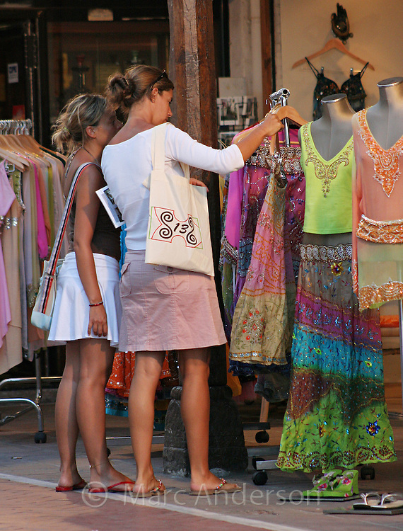 Two women shopping for clothes in Puerto Banus, Marbella, Spain