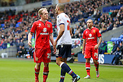 MK Dons midfielder, on loan from Crystal Palace, Jonny Williams  and Bolton Wanderers midfielder Darren Pratley  have a few words  during the Sky Bet Championship match between Bolton Wanderers and Milton Keynes Dons at the Macron Stadium, Bolton, England on 23 January 2016. Photo by Simon Davies.