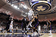 SOUTH BEND, IN - DECEMBER 21: Pat Connaughton #24 of the Notre Dame Fighting Irish shoots a layup over T.J. Cline #0 of the Niagara Purple Eagles at Purcel Pavilion on December 21, 2012 in South Bend, Indiana. (Photo by Michael Hickey/Getty Images) *** Local Caption *** Pat Connaughton; T.J. Cline