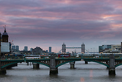 © Licensed to London News Pictures. 19/10/2016. LONDON, UK.  Colourful clouds seen above the River Thames and London Tiwer Bridge in London this morning as the weather feels colder than it has done in recent days. Photo credit: Vickie Flores/LNP
