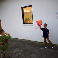 CORDOVA, SC - FEBRUARY 27:  Jah'Mir Wright, 7, holds a bouquet of balloons outside of the Cordova Town Hall polling precinct, which was also the venue for a 4 year old's birthday party on the day of the South Carolina Democratic Presidential Primary February 27, 2016 in Cordova, South Carolina.  Voters arrived to cast their ballots for the South Carolina Democratic Presidential Primary between Democratic Presidential candidates, former Secretary of State Hillary Clinton and Senator Bernie Sanders of Vermont.  (Photo by Mark Makela/Getty Images)