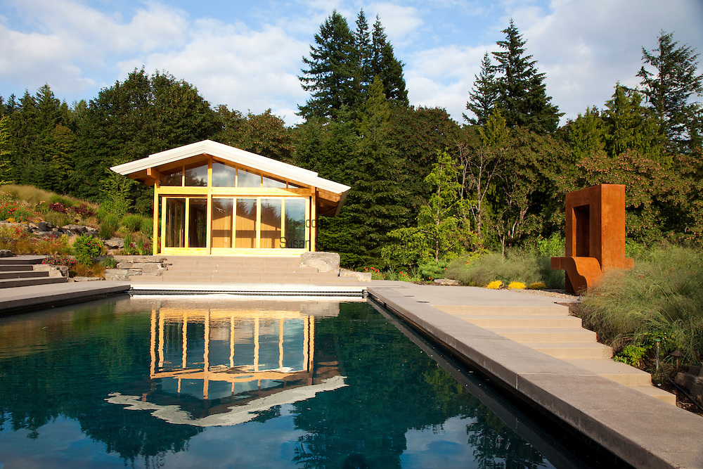 """The view of the yoga studio, swimming pool and Lee Kelly sculpture entitled, """"Window to the Gone World,"""" in the late afternoon"""