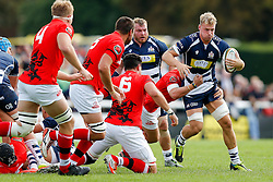 Bristol Rugby Number 8 Mitch Eadie is tackled by London Welsh Scrum-Half Rob Lewis - Mandatory byline: Rogan Thomson/JMP - 07966 386802 - 13/09/2015 - RUGBY UNION - Old Deer Park - Richmond, London, England - London Welsh v Bristol Rugby - Greene King IPA Championship.
