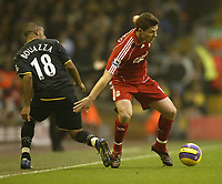 Photo: Aidan Ellis.<br /> Liverpool v Watford. The Barclays Premiership. 23/12/2006.<br /> Liverpool's  Xabi Alonso hets the better of Watford's Hameur Bouazza