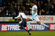 Bolton Wanderers striker Adam Le Fondre (9) and Sunderland defender Lamine Kone (23) clash during the EFL Sky Bet Championship match between Bolton Wanderers and Sunderland at the Macron Stadium, Bolton, England on 20 February 2018. Picture by Craig Galloway.