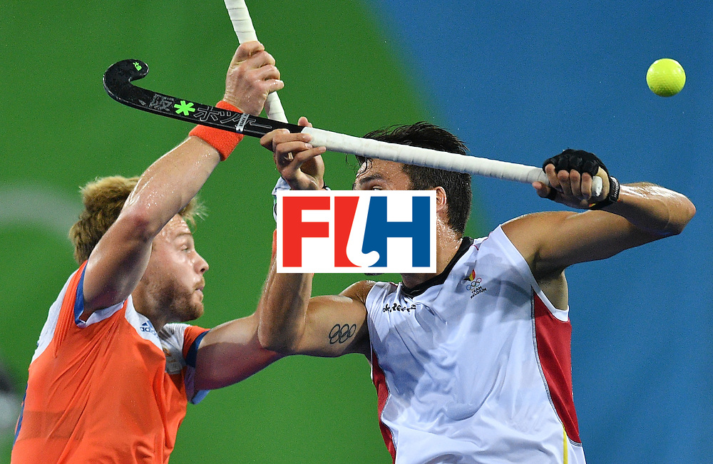 Belgium's Simon Gougnard (R) vies with Netherland's Mink van der Weerden during the men's semifinal field hockey Belgium vs Netherlands match of the Rio 2016 Olympics Games at the Olympic Hockey Centre in Rio de Janeiro on August 16, 2016. / AFP / Carl DE SOUZA        (Photo credit should read CARL DE SOUZA/AFP/Getty Images)