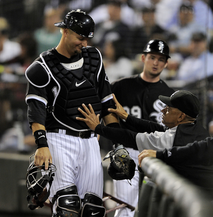 CHICAGO - SEPTEMBER 23:  A.J. Pierzynski #12 smiles as bench coach Joey Cora #28 of the Chicago White Sox playfully keeps Pierzynski from falling into the dugout during the game against the Minnesota Twins on September 23, 2009 at U.S. Cellular Field in Chicago, Illinois.  (Photo by Ron Vesely)
