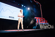 Tom Grundy speaks on stage during the TEDxWanChai event Emergence on Jun 2, 2018, in Hong Kong. / Moses Ng / MozImages