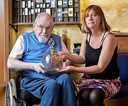 Pictured: Alasdair Gray and Siobhan Healy with one of the glass pieces.<br /> <br /> Edinburgh Art Festival prepared for the 2018 festival by showcasing ornate decorated glassware by celebrated artist Siobhan Healy, and featured words by renowned writer Alasdair Gray. The Festival, Scotland's leading visual arts event, runs from 26 July to 26 August.<br /> <br /> &copy; Dave Johnston / EEm