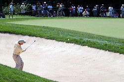 16 July 2006 Joe Ogilvie pitches out of theleft bunker next to the green on #9. The John Deere Classic is played at TPC at Deere Run in Silvis Illinois, just outside of the Quad Cities