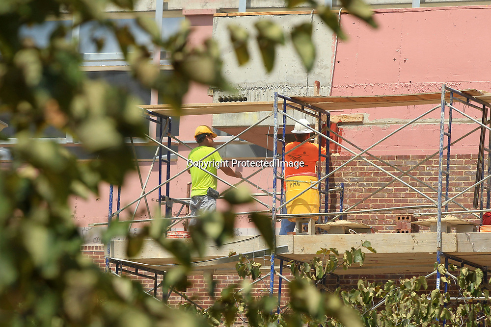 Construction crews lay brick at the Student Union building on the University of Mississippi Campus on Monday afternoon in Oxford.