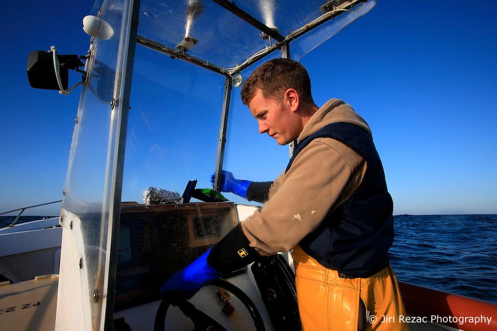 UK ENGLAND CORNWALL SENNEN COVE 11JUN08 - Handline fisherman Will Treneer (19) of Newlyn observes the echosound screen as he fishes for Pollack off the coast of southwest Cornwall on his boat, the Cornish Rose...jre/Photo by Jiri Rezac / WWF UK..© Jiri Rezac 2008..Contact: +44 (0) 7050 110 417.Mobile:  +44 (0) 7801 337 683.Office:  +44 (0) 20 8968 9635..Email:   jiri@jirirezac.com.Web:    www.jirirezac.com..© All images Jiri Rezac 2008 - All rights reserved.