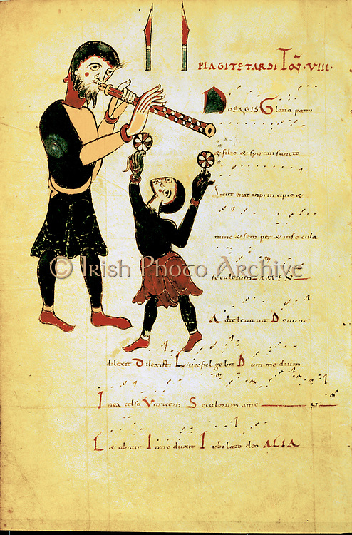 Jongleur and an acrobat or juggler: A jongleur was a person professionally engaged in musical entertainment.  11th century anonymous manuscript.