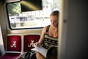 TUSCALOOSA, AL – SEPTEMBER 28, 2016: Freshman Brianna Zavolowitz takes a few moments to study on the way to class. A native of Staten Island, Zavolowitz came to the University of Alabama on full scholarship as an out of state student. Despite the rising cost of college tuition nationwide, in state student enrollment is becoming less profitable for major public universities. In response to these financial shortfalls, flagship universities around the country are working hard to rebrand themselves as attractive institutions for out of state students. The University of Alabama has begun an aggressive campaign to recruit out of state students, as the revenue from those students is much greater. CREDIT: Bob Miller for The New York Times