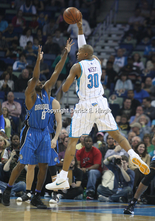 18 February 2009: New Orleans Hornets forward David West (30) passes the ball as Orlando Magic guard Anthony Johnson (8) defends during a NBA basketball game between the Orlando Magic and the New Orleans Hornets at the New Orleans Arena in New Orleans, Louisiana.