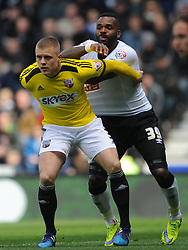 Brentfords Jake Bidwell battles with Derby Darren Bent, Derby County v Brentford, Sy Bet Championship, IPro Stadium, Saturday 11th April 2015. Score 1-1,  (Bent 92) (Pritchard 28)<br /> Att 30,050