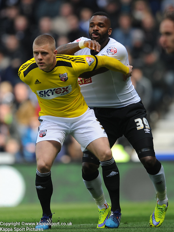Brentfords Jake Bidwell battles with Derby Darren Bent, Derby County v Brentford, Sy Bet Championship, IPro Stadium, Saturday 11th April 2015. Score 1-1,  (Bent 92) (Pritchard 28)<br /> Att 30,050