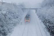 Trains are still running on the First Great Western Bristol to London line despite heavy overnight snow causing disruption in rural Wiltshire. January 18 2013. Corsham, UK..Photo by: Mark Chappell/i-Images