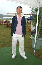 Fashion designer MATTHEW WILLIAMSON at the 2005 Cartier International Polo between England & Australia held at Guards Polo Club, Smith's Lawn, Windsor Great Park, Berkshire on 24th July 2005.<br />