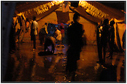 Bea Ahbeck/Fremont Argus<br /> <br /> Night commuters clean up the floor after sleeping the night at Noah's Ark, one of the shelters provided for night commuters in Gulu, Northern Uganda Saturday morning, October 29, 2005. Thousands of children make the commute every night from surrounding villages to avoid being abducted by the Lord's Resistance Army and turned into child soldiers or sex slaves. Joseph Kony's rebel army have abducted over 20,000 children in the last 18 years of war.