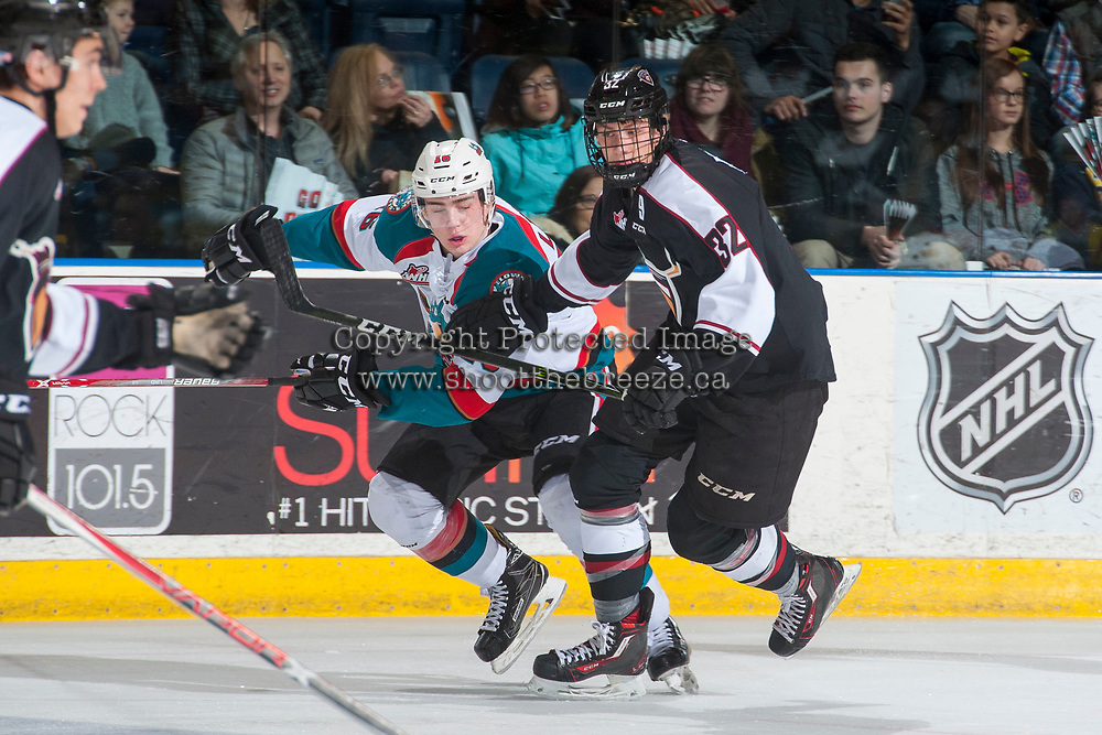 KELOWNA, CANADA - MARCH 10: Evan Patrician #32 of the Vancouver Giants checks Kole Lind #16 of the Kelowna Rockets on March 10, 2017 at Prospera Place in Kelowna, British Columbia, Canada.  (Photo by Marissa Baecker/Shoot the Breeze)  *** Local Caption ***