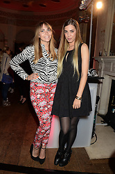 Left to right, BECKY TONG and AMBER LE BON at the Juicy Couture - Viva La Juicy perfume Party held at Home House, Portman Square, London on 30th May 2013.