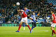 Middlesbrough defender Dael Fry (20) and Sheffield Wednesday forward Steven Fletcher (9) contest an aerial ball  during the EFL Sky Bet Championship match between Sheffield Wednesday and Middlesbrough at Hillsborough, Sheffield, England on 19 October 2018.