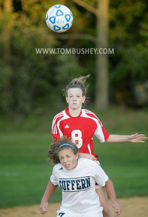 Suffern, NY - A North Rockland player heads the ball over a Suffern player in a high school girls' soccer game on Tuesday, Oct. 13, 2009.