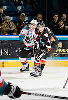 KELOWNA, CANADA, JANUARY 1: Carter Rigby #11 of the Kelowna Rockets is blocked by Peter Kosterman #4 of the Calgary Hitmen as the Calgary Hitmen visit the Kelowna Rockets on January 1, 2012 at Prospera Place in Kelowna, British Columbia, Canada (Photo by Marissa Baecker/Getty Images) *** Local Caption ***