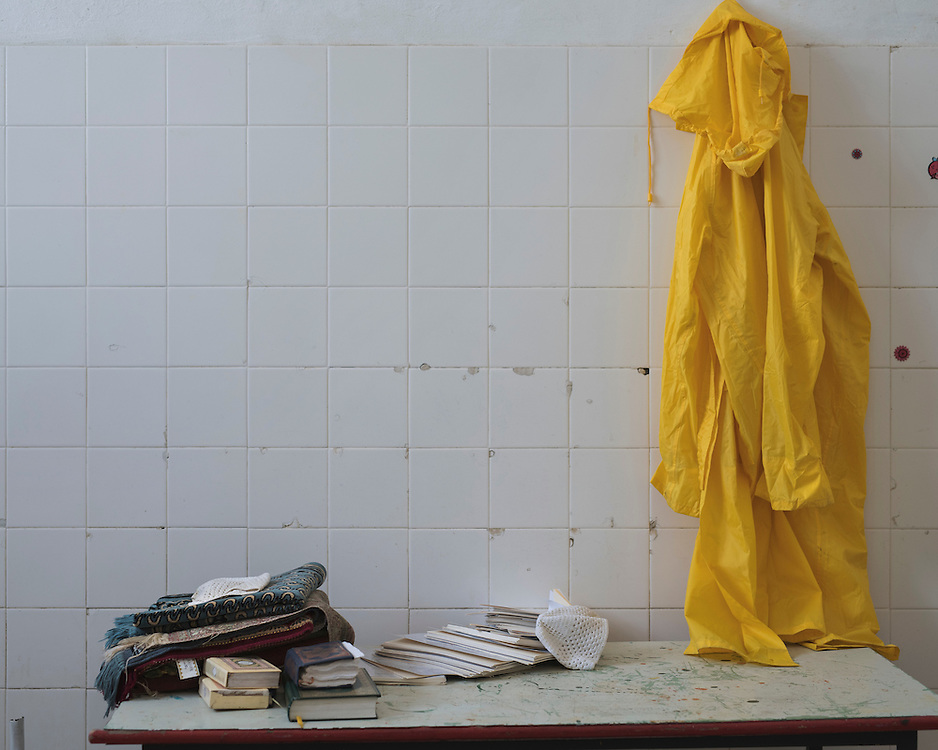 A rain coat and copies of the Quran in a building in the closed down refugee camp at the Port of Lakki. <br />