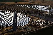 Site de la tour PS10 de la centrale solaire de Sanlucar la Mayor, pres de Seville, Espagne, le 29 Avril 2008. La centrale solaire, la premiere centrale commerciale au monde, appartenant a la societe espagnole Solucar (Abengoa), peut produire de l'electricte pour 6000 habitations. Solucar (Abengoa) projete de construire un total de 9 nouvelles tours dans les 7 ans qui viennent, afin de fournir 180 000 habitations en electricite. Photographe: Markel Redondo/Fedephoto pour Greenpeace...The PS10 solar tower plant sits at Sanlucar la Mayor outside Seville on April 29, 2008 in Seville, Spain. The solar tower plant, the first commercial solar tower in the world, by the Spanish company Solucar (Abengoa), can provide electricity for up to 6,000 homes. Solucar (Abengoa) plans to build a total of 9 solar towers over the next 7 years to provide electricity for an estimated 180,000 homes. Photographer: Markel Redondo/Fedephoto for Greenpeace.Site de la tour PS10 de la centrale solaire de Sanlucar la Mayor, pres de Seville, Espagne. La centrale solaire, la premiere centrale commerciale au monde, appartenant a la societe espagnole Solucar (Abengoa), peut produire de l'electricte pour 6000 habitations. Solucar (Abengoa) projete de construire un total de 9 nouvelles tours dans les 7 ans qui viennent, afin de fournir 180 000 habitations en electricite. Photographe: Markel Redondo/Fedephoto pour Greenpeace...The PS10 solar tower plant sits at Sanlucar la Mayor outside Seville, Spain. The solar tower plant, the first commercial solar tower in the world, by the Spanish company Solucar (Abengoa), can provide electricity for up to 6,000 homes. Solucar (Abengoa) plans to build a total of 9 solar towers over the next 7 years to provide electricity for an estimated 180,000 homes. Photographer: Markel Redondo/Fedephoto for Greenpeace.